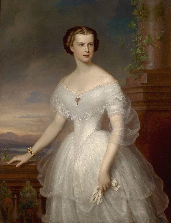L'immagine contiene un dipinto che ritrae l'imperatrice Elisabetta di Baviera, in abito bianco